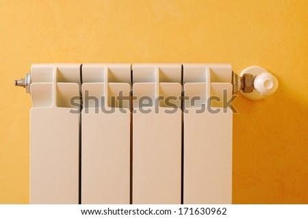 White aluminum heating radiator front view - stock photo