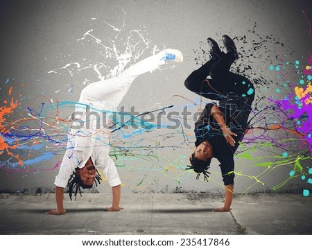 White and black fighting dancing colourful capoeira - stock photo