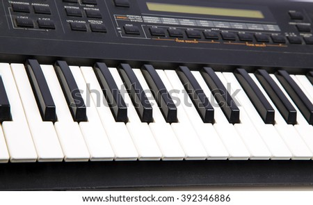 white and black keyboard keys , musical  instruments, song ,lovely , music,closeup piano, studio ,professional  performance, classic music ,piano keys close-up ,keys ,macro,entertainment,composing