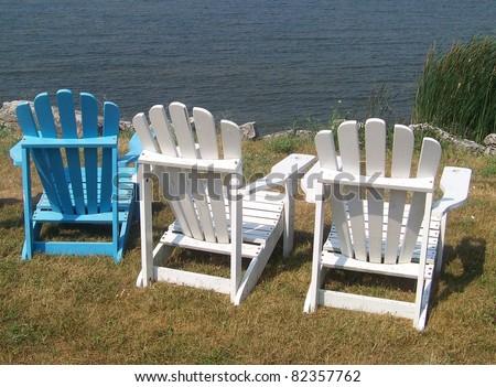 White and Blue Adirondack Chairs - stock photo