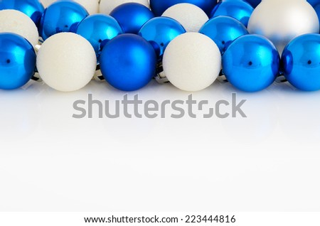 white and blue Christmas balls on white background horizontal. space for text