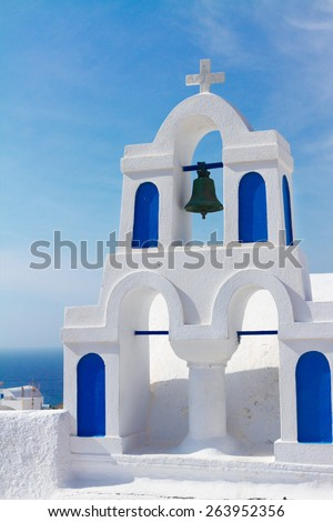 white and blue church belfry at sunny day,  Santorini island, Greece - stock photo