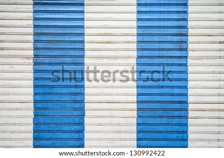 white and blue strip on metal door - stock photo