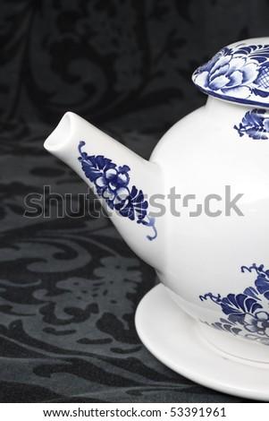 White and blue teapot - stock photo