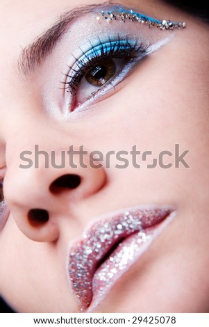 White and blue with silver sparkle make-up - stock photo
