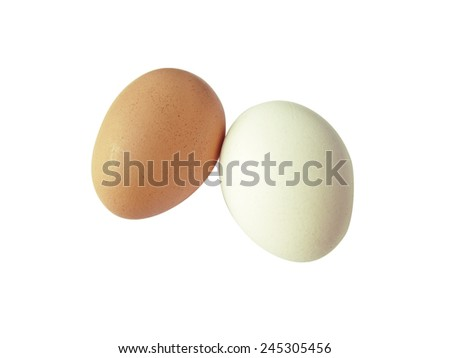 White and brown eggs, isolated in white background - stock photo