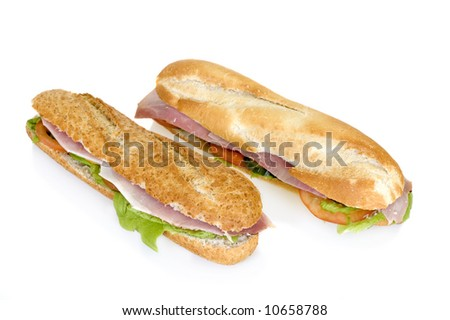 White and brown French bread with ham and cheese isolated on white background - stock photo