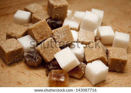 White and brown sugar caramel - stock photo