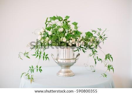 White green flower arrangement silver vase stock photo royalty free white and green flower arrangement in a silver vase mightylinksfo