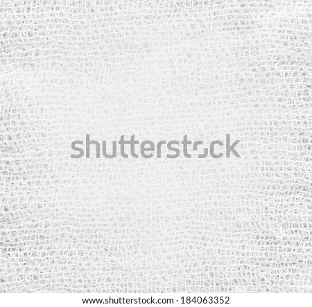 White and light gray texture of gauze background with sparse threads and clear space for your own text - stock photo