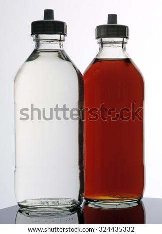 WHITE AND MALT VINEGAR - stock photo