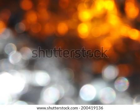 White and Orange Bokeh Background - stock photo