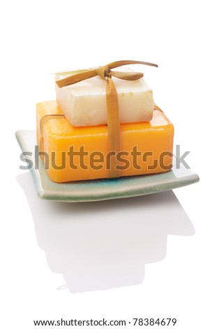 white and orange soaps isolated with path - stock photo
