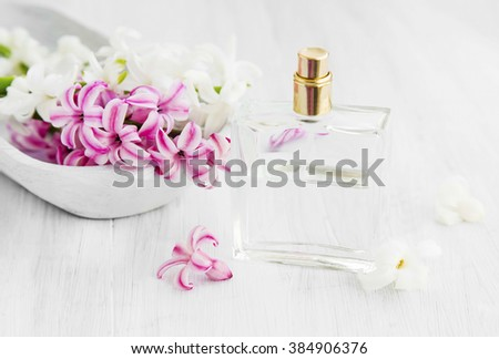 White and pink hyacinth flowers with perfume bottle.Spring flowers perfume - stock photo