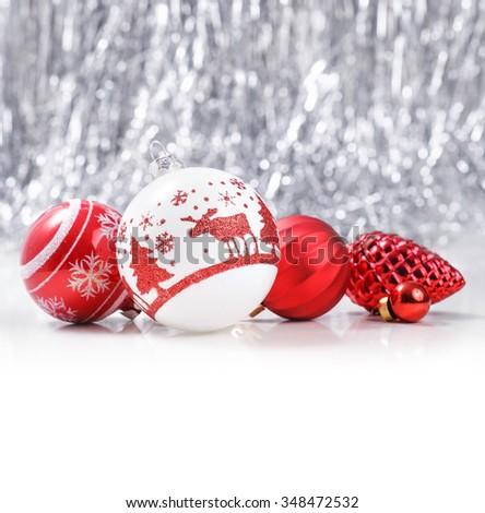 White and Red Christmas ornaments on glitter bokeh background with space for text. Xmas and Happy New Year theme - stock photo