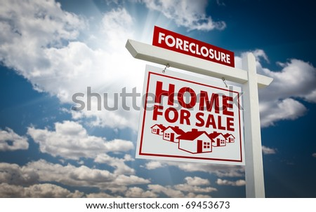 White and Red Foreclosure Home For Sale Real Estate Sign Over Beautiful Clouds and Blue Sky. - stock photo