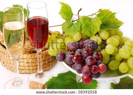white and red grape cluster and glasses of wine - stock photo