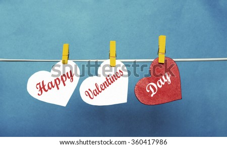 white and Red hearts with clothespins hanging on clothesline  on blue background. date, love Happy Valentines Day concept - stock photo