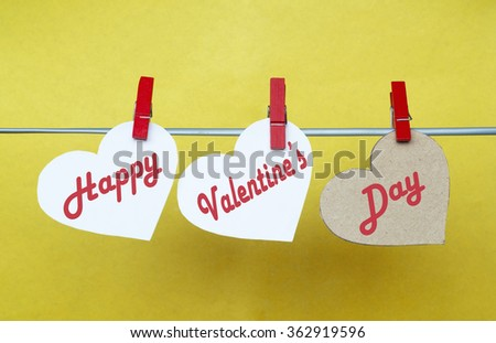 white and Red hearts with clothespins hanging on clothesline on color background. date, love Happy Valentines Day concept - stock photo