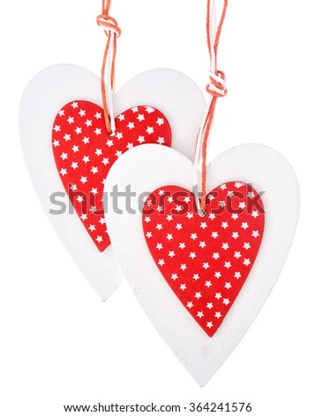 White and red sewed christmas hearts isolated on background, Holiday background for greetings Valentine's  day