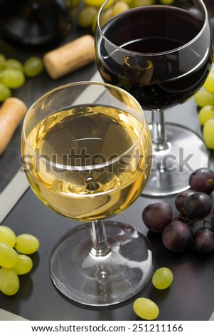 white and red wine in glasses closeup, vertical - stock photo