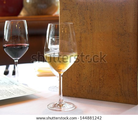 white and red wine with generic menu in restaurant - stock photo
