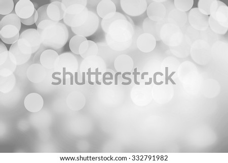 White and silver abstract bokeh lights. Sparkling Christmas defocused background - stock photo