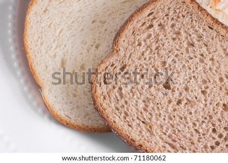 White and Whole Wheat Bread Slices - stock photo