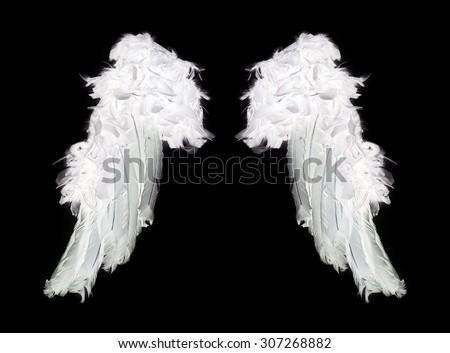 White angel wings on black background