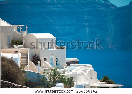 White architecture against mountains background on Santorini island , Greece