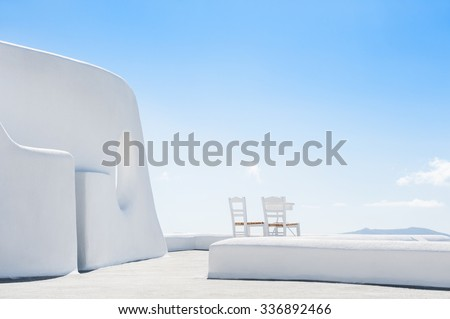 White architecture on Santorini island, Greece. Beautiful terrace with two chairs - stock photo