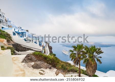 White architecture on Santorini island, Greece.  Foggy morning. Beautiful landscape with sea view - stock photo