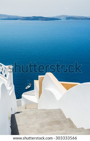 White architecture on Santorini island, Greece. Stairs to the sea. Beautiful landscape with sea view. Selective focus