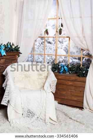 White arm-chair near the window in Christmas Decor - stock photo