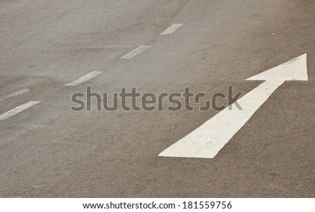 white arrow marking on road - stock photo