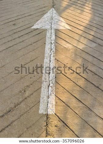 White arrow marking road - stock photo