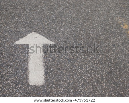 White arrow painted on the road