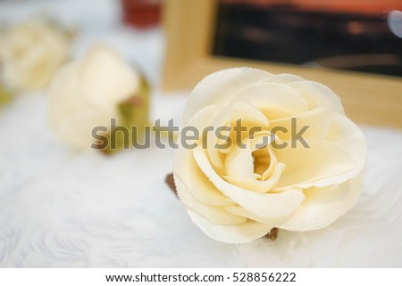 White artificial roses, soft focus, vintage style, white roses as a decoration for a wedding reception. love and romantic concept (wedding, Valentine's or anniversary)