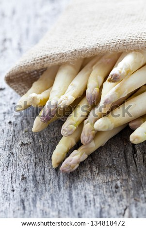 white asparagus on wooden background - stock photo