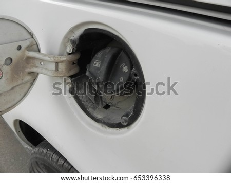 White automobile gas cap Open