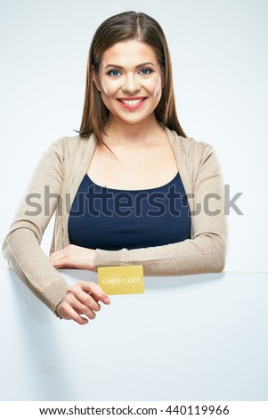 White background isolated portrait of young woman show credit card. Smiling girl with long hair. - stock photo
