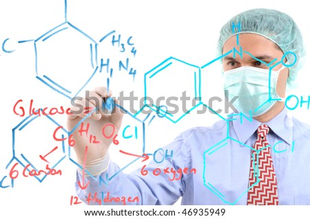 White background studio image of a medical researcher writing formula on glass. Focused on hand, face out of focus - stock photo