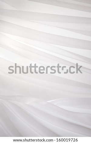 White background with elegant drapery fabric, vertical view. - stock photo