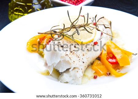 white baked cod with pepper and rosemary - stock photo