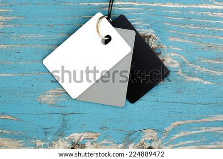 white balance cards weathered paint wooden background - stock photo