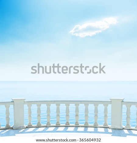 white balcony near sea and blue sky with clouds - stock photo