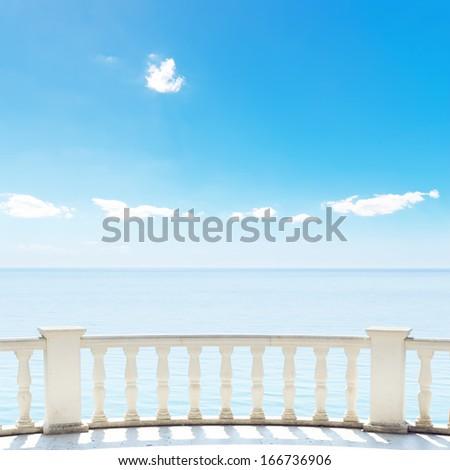 white balcony on terrace near sea and blue sky - stock photo