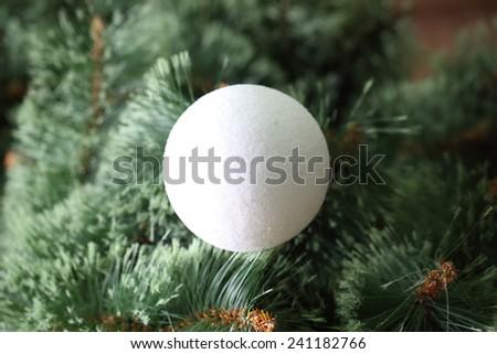 White ball on the Christmas tree - stock photo