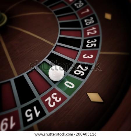white ball running on roulette wheel - stock photo