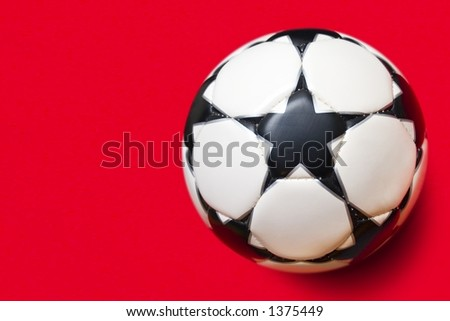 White ball with black stars on a red background - stock photo